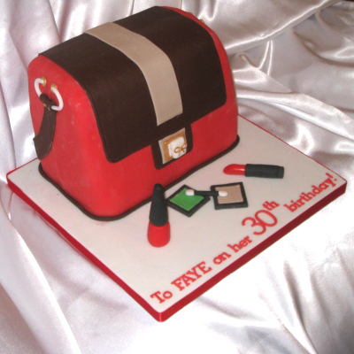 Anya Hindmarch cake with edible make-up eye shadow lipstick nail polish