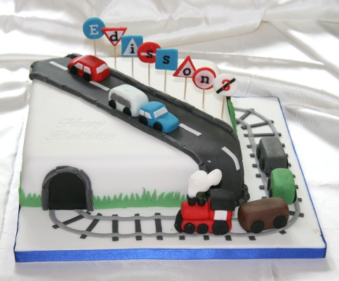 Birthay cake with trains, cars and traffic signs