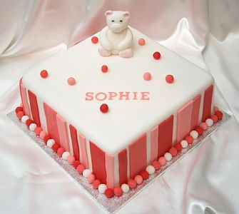 Birthday cake with teddy bear and stripe detail