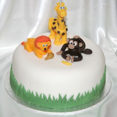 Cake with lion, giraffe and monkey