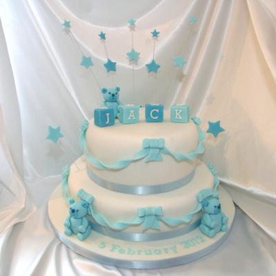 Christening cake with little bears and letter cubes
